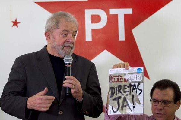 Lula promete estar 'na trincheira' para que Temer 'saia logo' da Presidência